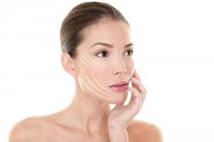 Skin care Asian model touching face with lifting arrows lines facelift